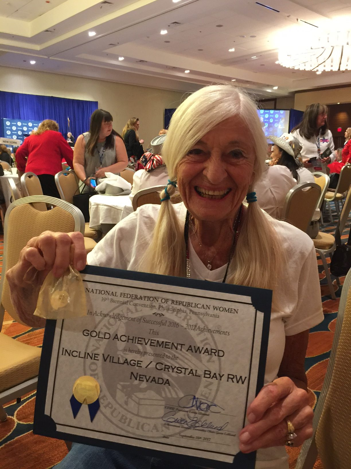 A beaming Joanellen Slocumb proudly displays our club's Gold Achievement Award.